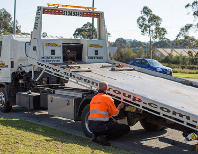 car towing prices melbourne sheen employee and tow truck